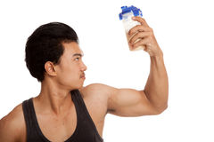 Muscular Asian man  flexing biceps with whey protein shakes Stock Photo