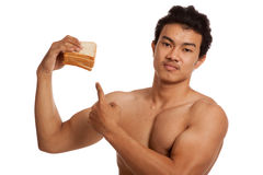 Muscular Asian man load carbs point to bread Royalty Free Stock Image