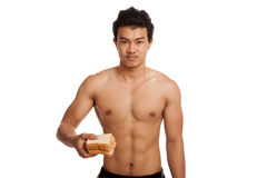 Muscular Asian man load carbs with some bread. Isolated on white background Stock Images