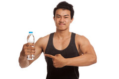 Muscular Asian man point to bottle of water Royalty Free Stock Images