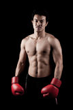 Muscular Asian man with red boxing glove Royalty Free Stock Photography