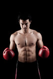 Muscular Asian man with red boxing glove Royalty Free Stock Images