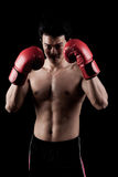 Muscular Asian man with red boxing glove Stock Photos