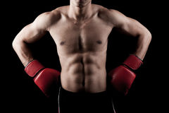 Muscular Asian man with red boxing glove Royalty Free Stock Photos