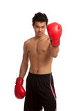 Muscular Asian man with red boxing glove Royalty Free Stock Photo