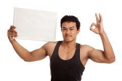 Muscular Asian man show OK with blank sign Stock Photo