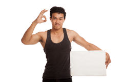 Muscular Asian man show OK with blank sign Stock Images