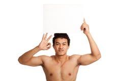 Muscular Asian man show OK with blank sign Stock Photos