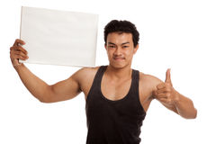 Muscular Asian man thumbs up with blank sign Stock Images