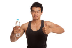 Muscular Asian man thumbs up with bottle of water Royalty Free Stock Images