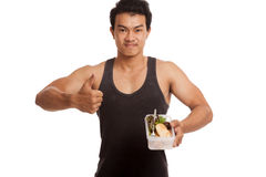 Muscular Asian man thumbs up with clean food in box Royalty Free Stock Image
