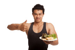Muscular Asian man thumbs up with clean food Stock Image