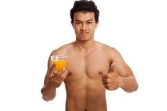 Muscular Asian man thumbs up with orange juice Stock Photos