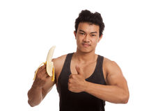 Muscular Asian man thumbs up with peeled banana Royalty Free Stock Images