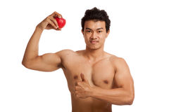 Muscular Asian man thumbs up with red apple Royalty Free Stock Image