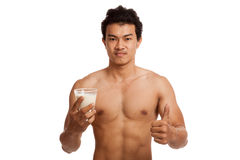 Muscular Asian man thumbs up with soy milk Royalty Free Stock Images