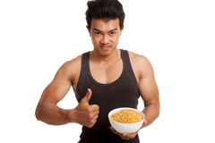 Muscular Asian man thumbs up with  soybean Royalty Free Stock Image