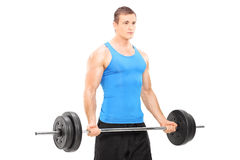 Muscular athlete holding a barbell Royalty Free Stock Photography