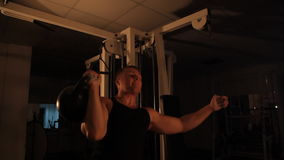 Muscular athlete lifts weights in the gym. stock footage
