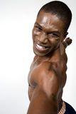 Muscular Athlete Portrait. A portrait of a muscular African American male athlete posing on a white background with his hands spread out. One is just under the Royalty Free Stock Photos