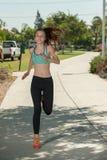 Muscular athlete running on the path Stock Photos