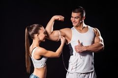 Muscular athlete shows thumb-up. Stock Photo