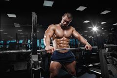 Muscular athletic bodybuilder fitness model posing Stock Images