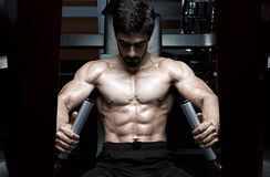 Muscular athletic bodybuilder fitness model Stock Photos