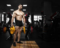 Muscular athletic bodybuilder fitness model royalty free stock photo