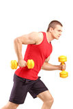 Muscular athletic man lifting weights. Isolated on white background Stock Image