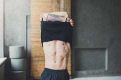 Muscular athletic man showing naked torso Stock Photo