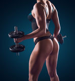 Muscular athletic woman working out with weights Royalty Free Stock Photos