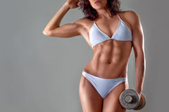 Muscular athletic young woman Royalty Free Stock Photo