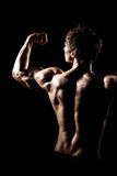 Muscular BACK of male model bodybuilder preparing for fitness tr Stock Images