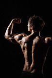 Muscular BACK of male model bodybuilder preparing for fitness tr Royalty Free Stock Photos