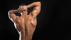 Muscular back and torso of young man. Perfect back muscles and biceps. Muscular back and torso of young man. Perfect back muscles and biceps stock image