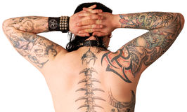 Muscular back with tattoo. Isolated against white background Royalty Free Stock Photo