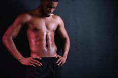muscular bare-chested african american man stock photo