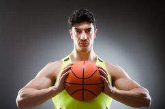 Muscular basketball in sports concept. The muscular basketball in sports concept royalty free stock photography