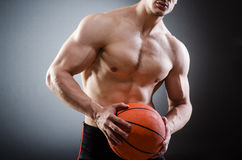 Muscular basketball in sports concept Royalty Free Stock Photography