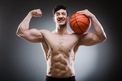 Muscular basketball in sports concept Stock Photos