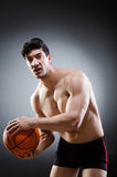 Muscular basketball in sports concept Royalty Free Stock Photo