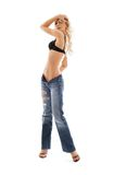 Muscular blond in blue jeans Royalty Free Stock Photo