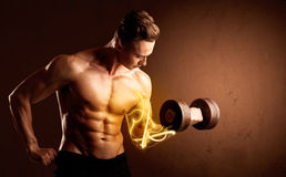 Muscular body builder lifting weight with energy lights on bicep Stock Image