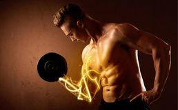 Muscular body builder lifting weight with energy lights on bicep Stock Images