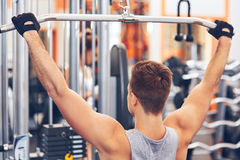 Muscular body building men training his back at the gym. Muscular body building man training his back at the gym Stock Photos