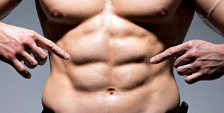 Muscular body of young man. royalty free stock photography