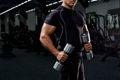 Muscular bodybuilder on black background.Strong athletic man. Stock Images