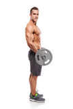 Muscular bodybuilder guy doing exercises with big dumbbell over Stock Images