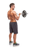 Muscular bodybuilder guy doing exercises with big dumbbell over Royalty Free Stock Image